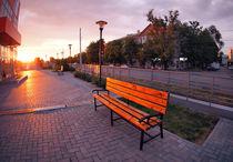 European urban sidewalk, benches and lanterns in the evening von Vladislav Romensky