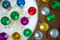 Colourful Arabic tea glasses from above by Perry  van Munster