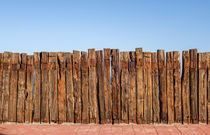 Wooden Fence Blue Sky von Perry  van Munster