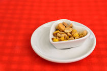 Heart Shaped Bowl With Dried Hard Fruits And Peanuts von Radu Bercan