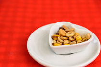 Heart Shaped Bowl With Dried Hard Fruits And Peanuts by Radu Bercan
