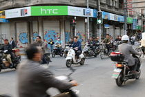 Shanghai motorbike traffic by Thomas Hammer