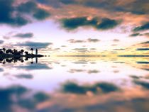 reflection of the cloudy sunset sky and ocean view by timla