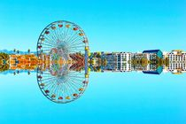 reflection ferris wheel with buildings and blue sky von timla