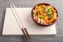 Asian dish of rice noodle in a small wooden bowl by Vladislav Romensky