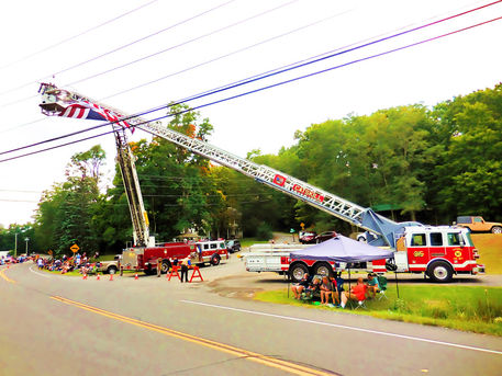 A-firetruck-ladder-the-is-fully-extenden-into-the-sky