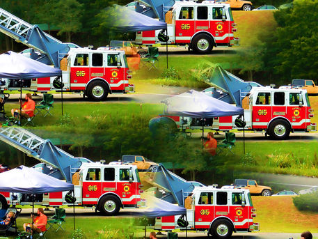 Fire-truck-with-ladder-extended-on-display-2