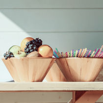 Fruit Bowl And Colorful Straws On Table by Radu Bercan