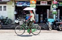 Young lady with umbrella von Manuel Bruque