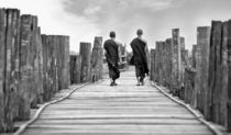 Monks on a bridge by Manuel Bruque