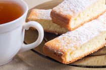 Tea and a plate of fresh biscuits by Vladislav Romensky