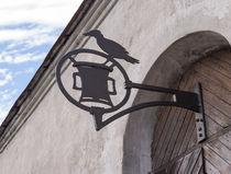 vintage wrought iron sign on wooden door von Andrey Lipinskiy