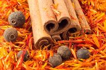 Cinnamon, peppercorn and saffron close-up by Vladislav Romensky