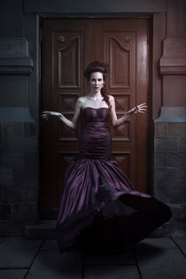 Beautiful woman in violet dress von Evgeniia Litovchenko