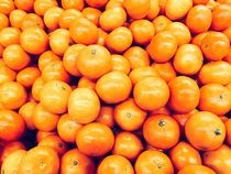 Orange Tangerines In Fruit Market by Radu Bercan