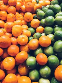 Lime And Tangerines Citrus Fruits In Fruit Market by Radu Bercan