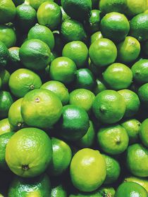 Lime Citrus Fruits In Fruit Market by Radu Bercan