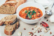 Chili Beans Stew, Bread, Red Chili Pepper And Garlic Ready To Be Served by Radu Bercan