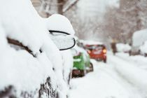 Cars Covered With Fresh White Snow After A Heavy Blizzard In Bucharest City von Radu Bercan