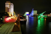 Colorful illuminated container terminal in Stuttgart by night by stephiii