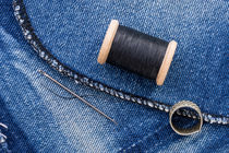 Roll of Black Thread and Jeans von maxal-tamor