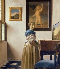 A Young Woman Standing at a Virginal von Jan Vermeer