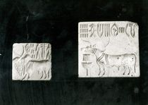 Two decorated seals depicting a zebu and a bull by Harappan