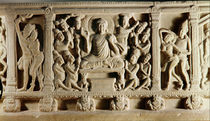 Relief depicting seated Buddha preaching surrounded by worshippers by Indian School