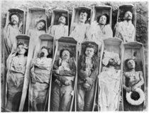 Communards in their coffins by Andre Adolphe Eugene Disderi