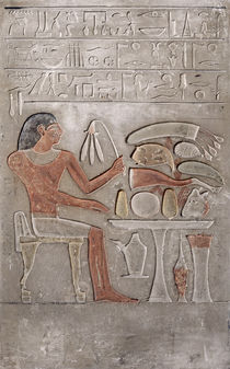 Stela depicting the deceased before an offering table by Egyptian