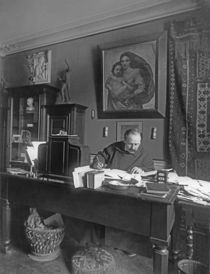 French composer Jules Massenet sitting at his desk by Dornac