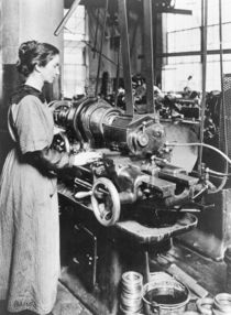 Woman working at internal thread milling machine by American Photographer