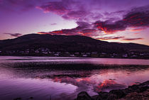 Reflection of purple sky and red clouds across Loch Portree von Bruce Parker