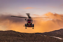 Coastguard helicopter, hovering in the air, on training exercise at Sligachan, Isle of Skye, Scotland. von Bruce Parker