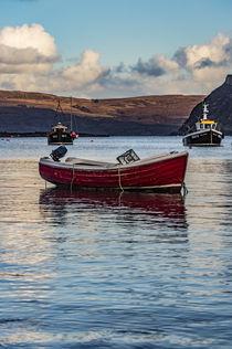 Small dinghy with outboard motor anchored in Portree Harbour, Isle of Scotland by Bruce Parker