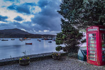 Telephone box with view of Ben Tianavaig and the pier at Portree Harbour by Bruce Parker
