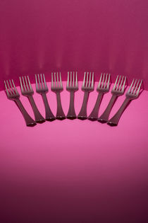 Abstract still life with forks on a pink background by Valentin Ivantsov