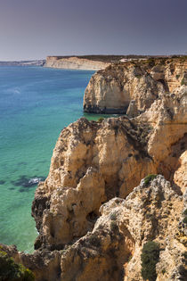 Coast with cliffs in Lagos at Algarve in Portugal by Bastian Linder