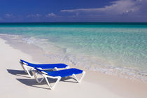 Caribbean beach with canvas chairs in Cuba by Bastian Linder