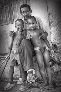 Cuban with children by Bastian Linder