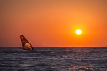 Windsurfing during sunset on sea by Bastian Linder