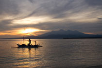 Sunrise above volcano Rinjani with fishing boat, Lombok by Bastian Linder