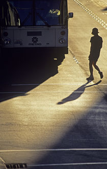 Silhouetted Teenager Crossing Street by Jim Corwin