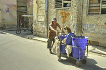 The Street Cleaner and his dog  by Rob Hawkins