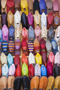 Displayed shoes in a shop in the souks of Marrakesh Morocco. by Danita Delimont