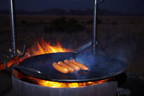 Sausages on barbeque, Desert Camp, Sesriem, Namib Desert, Na... von Danita Delimont