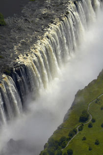 Tourists on pathway viewing Aerial view of Victoria Falls or... von Danita Delimont