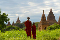 Monks with ancient temples and pagodas, Bagan, Mandalay Regi... by Danita Delimont