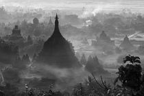 Ancient temples and pagodas in the jungle rising above sunse... by Danita Delimont