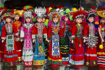 Dolls on display in Ethnic Native Dress, Kunming Ethnic Mino... by Danita Delimont
